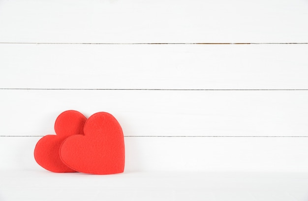 Two red hearts on white wooden background. love concept. valentines day. healthcare concept.