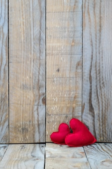 Two red hearts on a wooden background for valentine's day