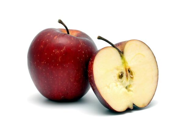 Два красных спелых яблока на белом фоне