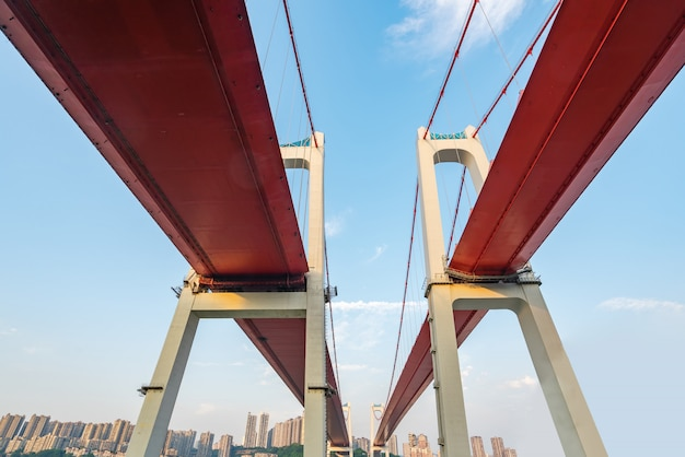 Two red suspension bridges on the yangtze river in chongqing, china