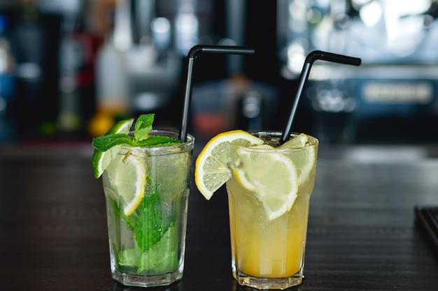 Two of refreshing lemonade with lemon and lime
