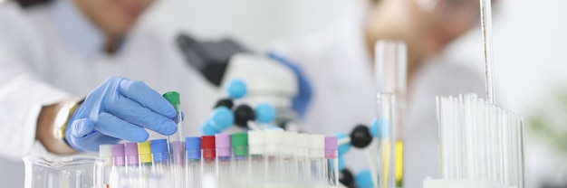 Two researchers are conducting experiments in laboratory