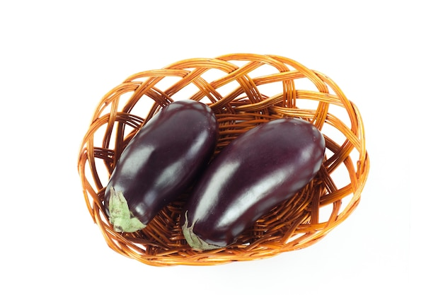 Two ripe eggplant in a wicker basket.isolated on white