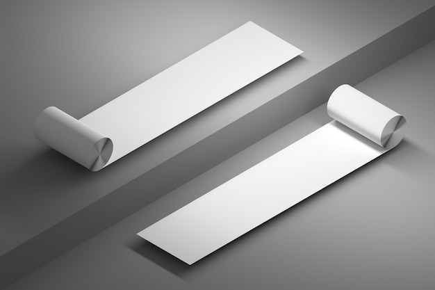 Two rolls of duct paper with blank empty surfaces over gray floor
