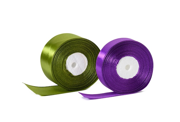 Two rolls of silk green and purple ribbon, wrapping decor, white isolated background