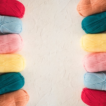 Two rows of colorful yarn