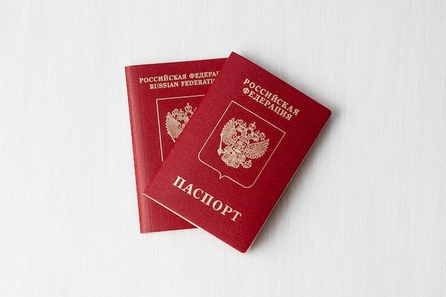 Two russian passports on white wall