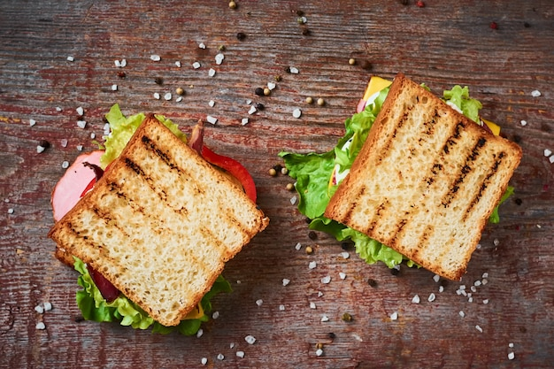 Two sandwiches with lettuce, top view