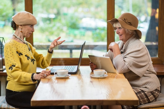 Two senior women in cafe