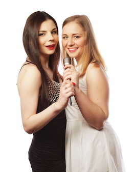 Two sensual girls singing with microphone