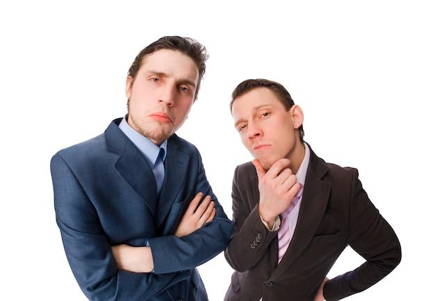 Two serious businessmen on white