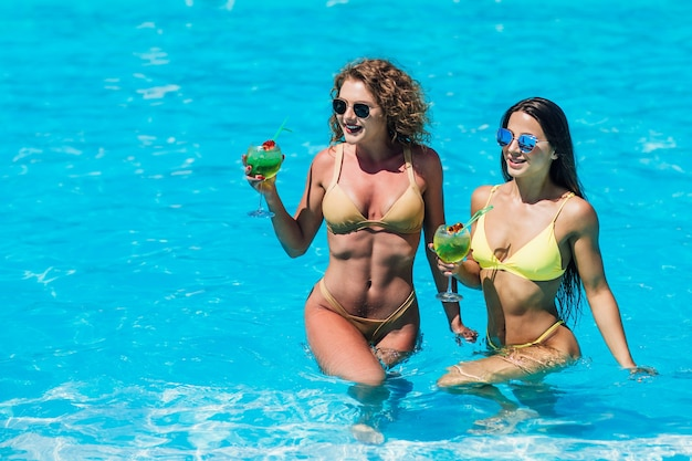 Two sexy girls in the pool