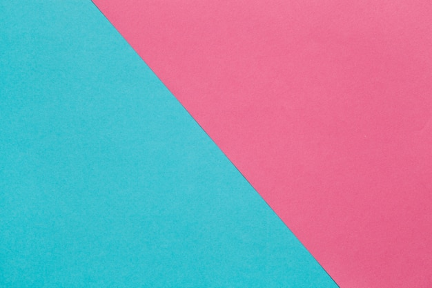 Two sheets of colored paper, pink and blue.