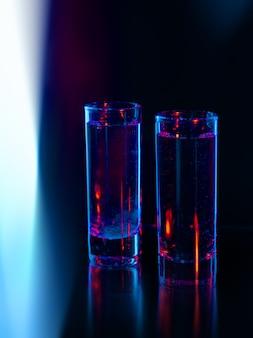 Two shots under a blue light