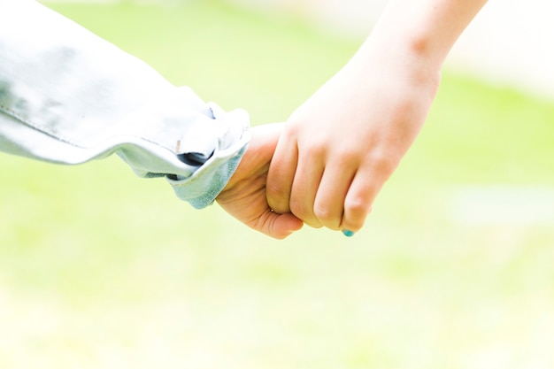 Two siblings holding hands