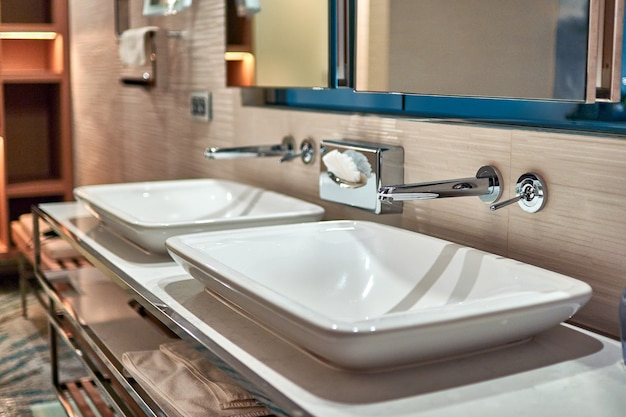 Two sinks in the bathroom in a hotel room