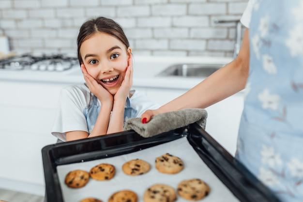 Two sisters bake cookie