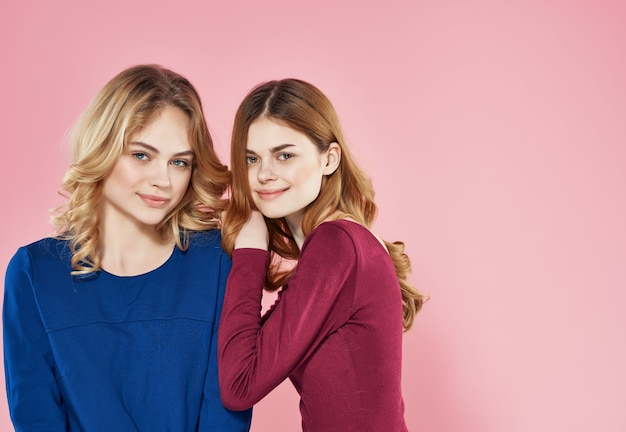 Two sisters in dresses hugs fun friendship emotions
