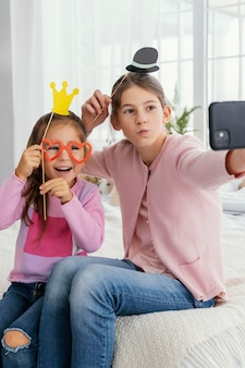 Two sisters at home taking selfie