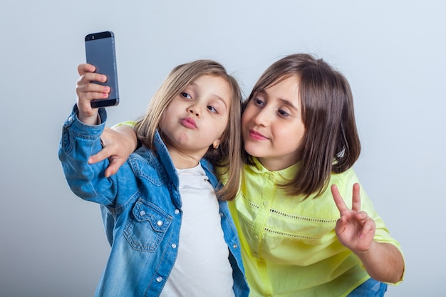 Two sisters posing and taking selfies