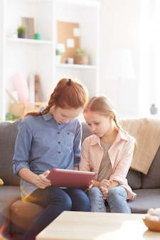 Two sisters using tablet