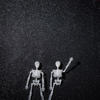Two skeletons greeting