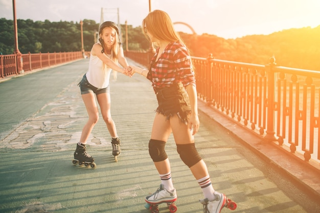 Two slim and sexy young women and roller skates