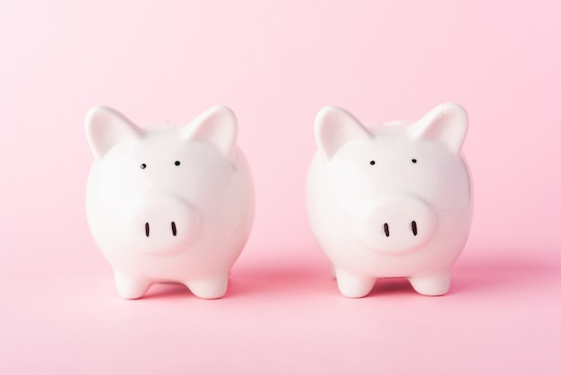 Two small white piggy banks