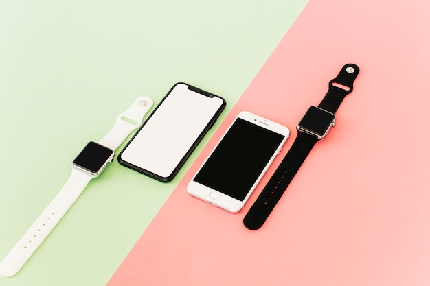 Two smartphones and smartwatches