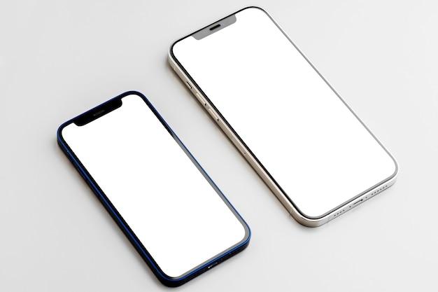 회색에 빈 흰색 화면이 두 스마트 폰