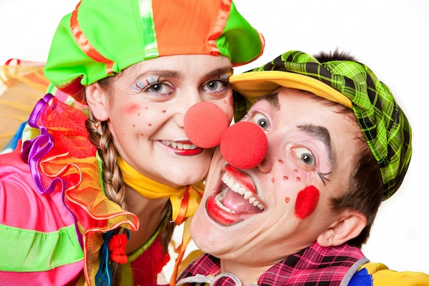 Two smiling clowns isolated over a white