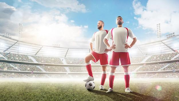 Два футболиста на стадионе.