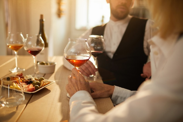 Two sommeliers examining wine closeup