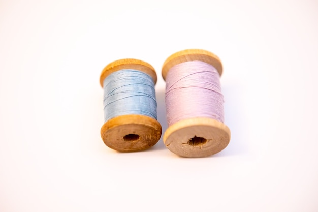 Two spools of thread on a white background