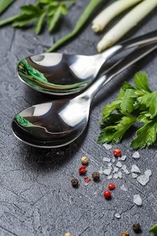 Two spoons on a dark background