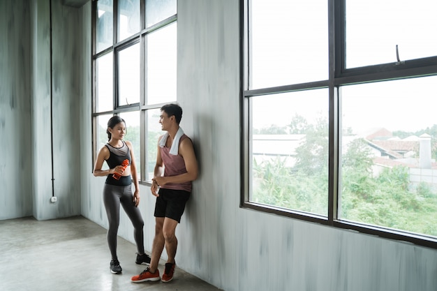 Two sport couple enjoy talking during workout