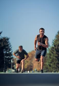 The two sportsmen running marathon in the beautiful park