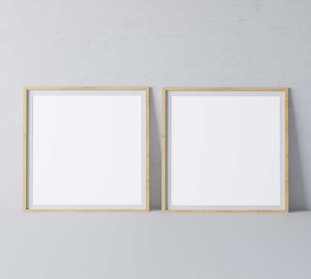 Two square wooden frames in modern design on minimal gray wall