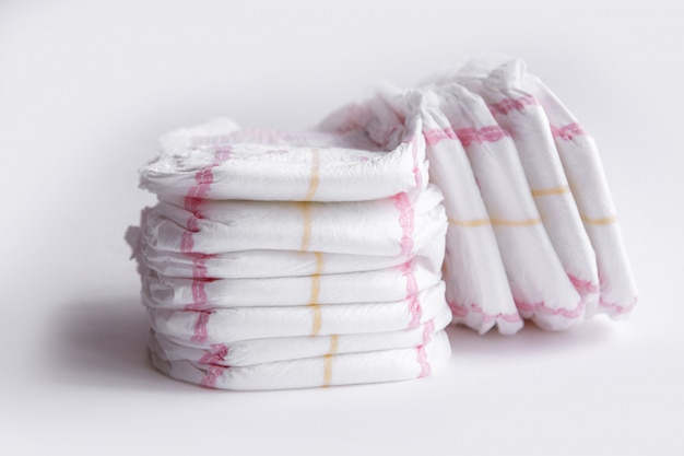 Two stacks of diapers isolated on white background