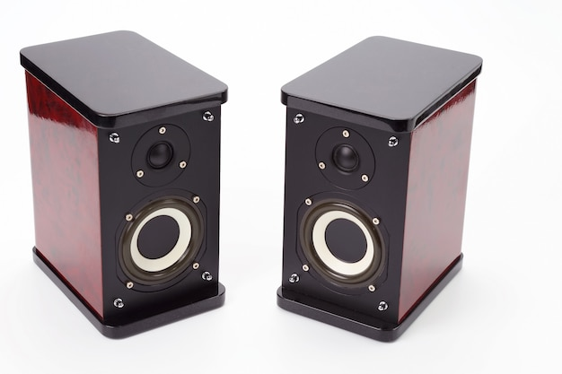 Two stereo audio speakers on white surface