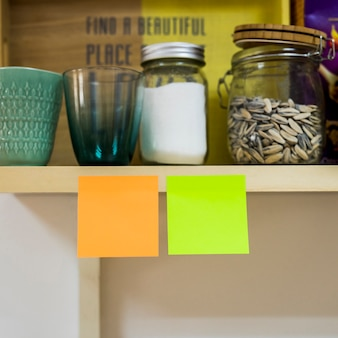 Two sticky notes in kitchen
