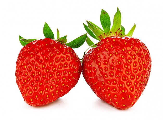 Two strawberries isolated on white background. macro.