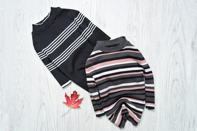 Two striped tops with red maple leaf