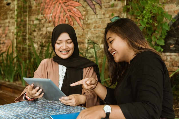 Two student girl using her tablet pc