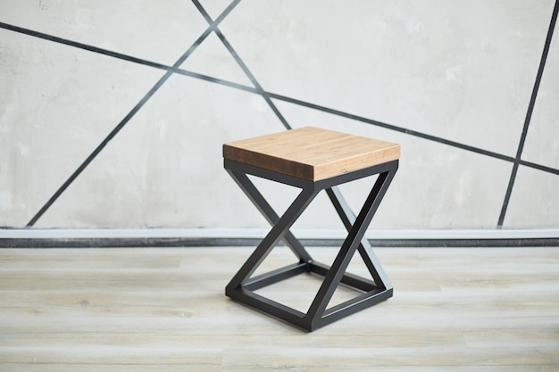 Two stylish chairs made of wood and metal. photo with copy space
