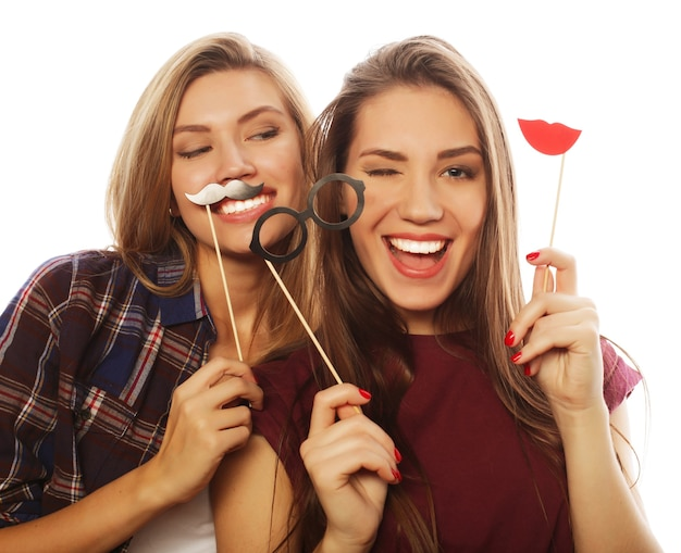 Two stylish sexy hipster girls best friends ready for party, over white background