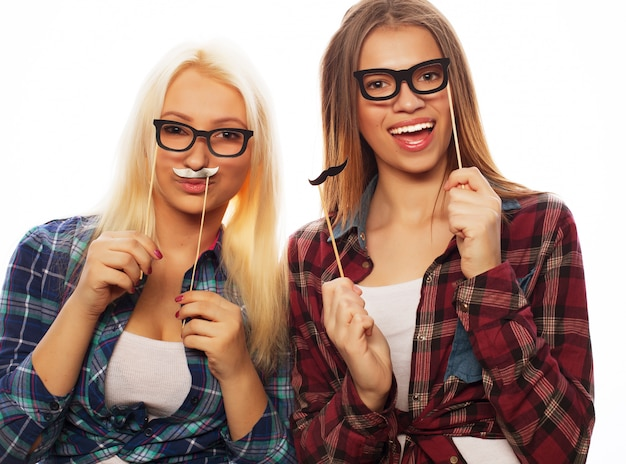 Two stylish sexy hipster girls