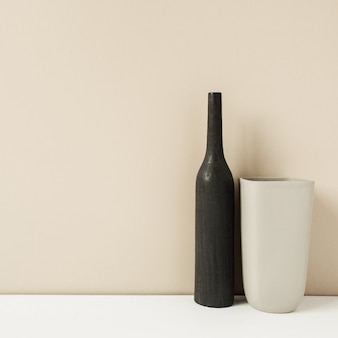 Two stylish vases on pastel neutral. modern interior decoration design concept.