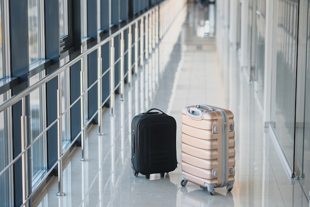 Two suitcases in the airport departure lounge
