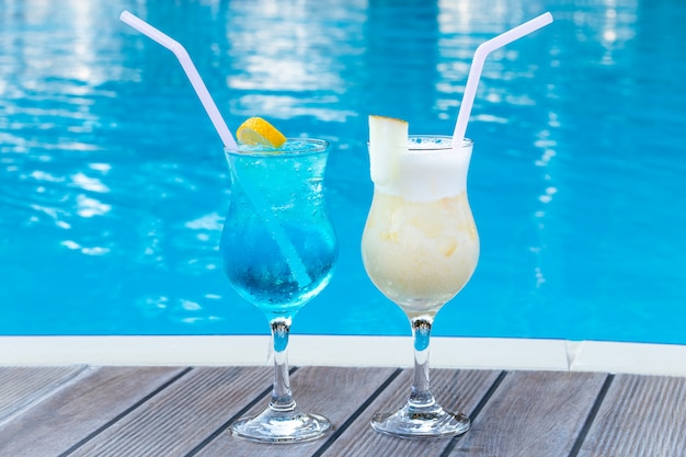Two summer sweet cocktails by the pool.